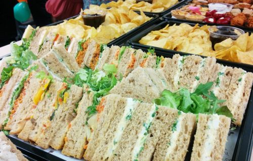 A selection of sandwiches, crisps, savoury snacks and dips. Corporate catering for meetings, lunches and parties.  Close up image of food.
